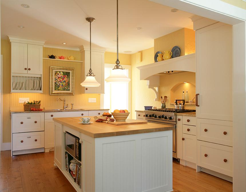 Kitchen staged with a bowl of fruit on the counter