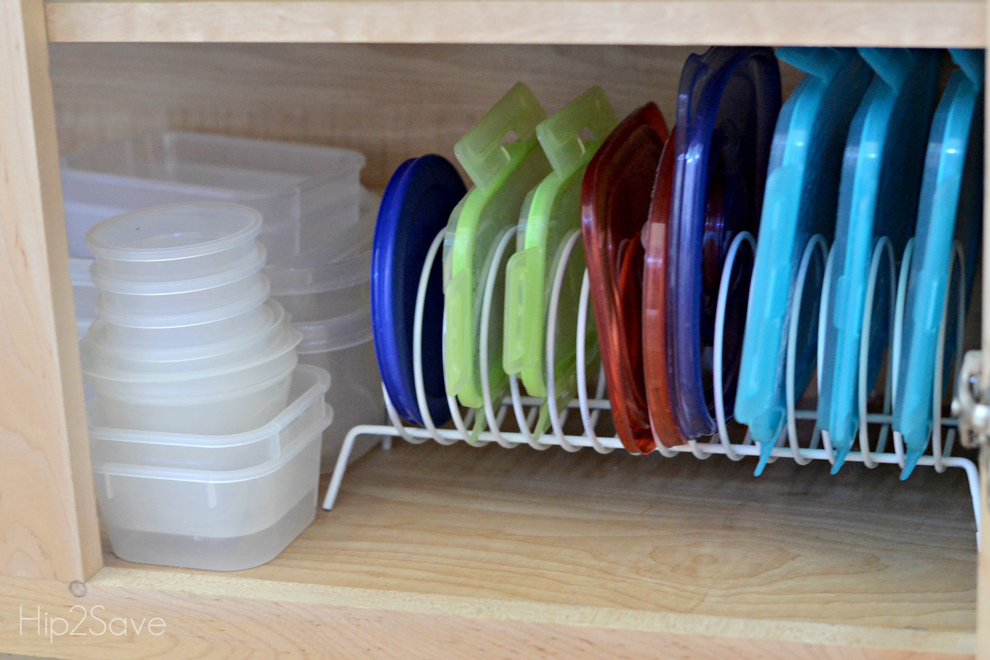 Tupperware lids stored in a CD holder