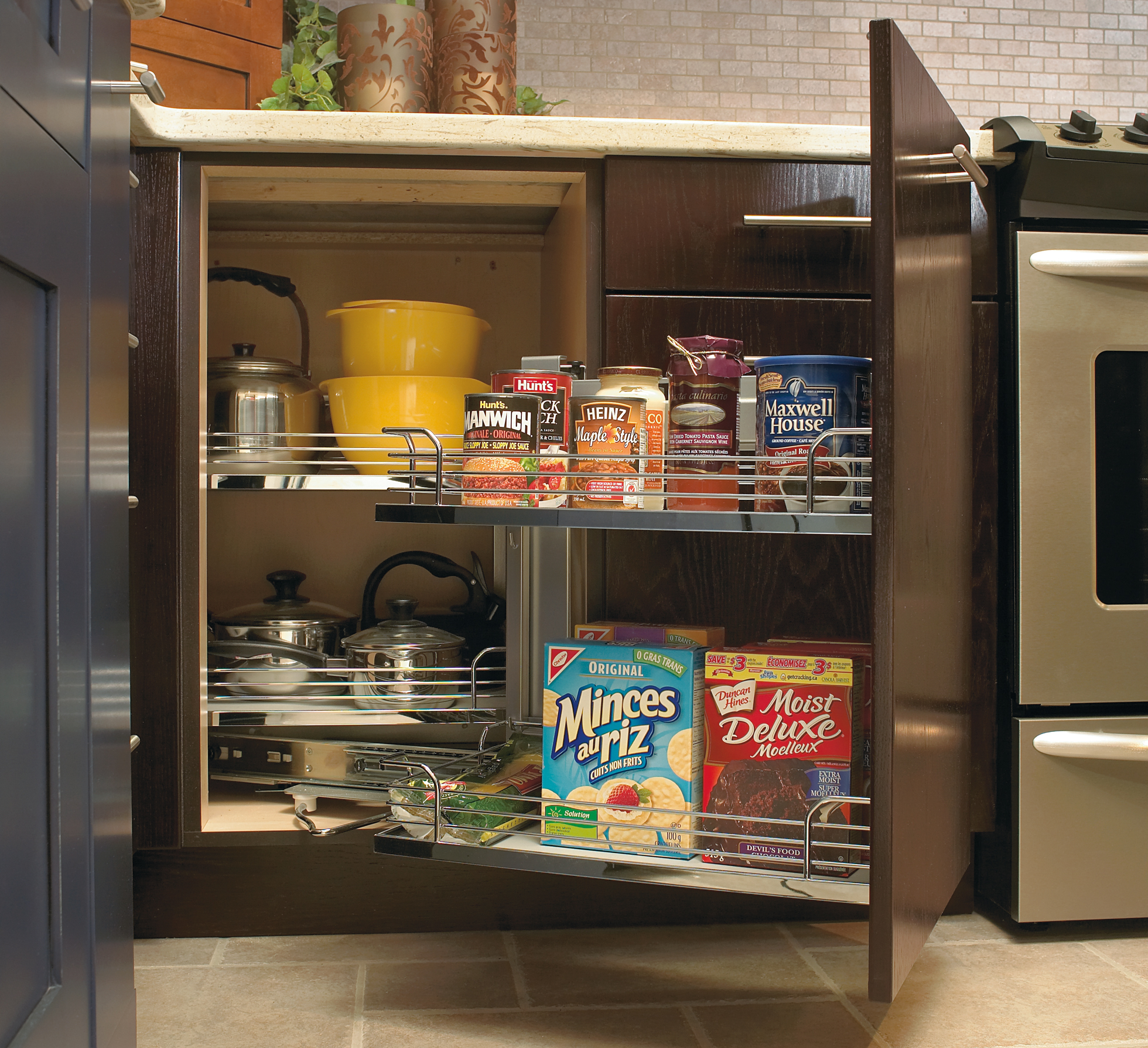 Pull-out cabinets hold food items in a kitchen