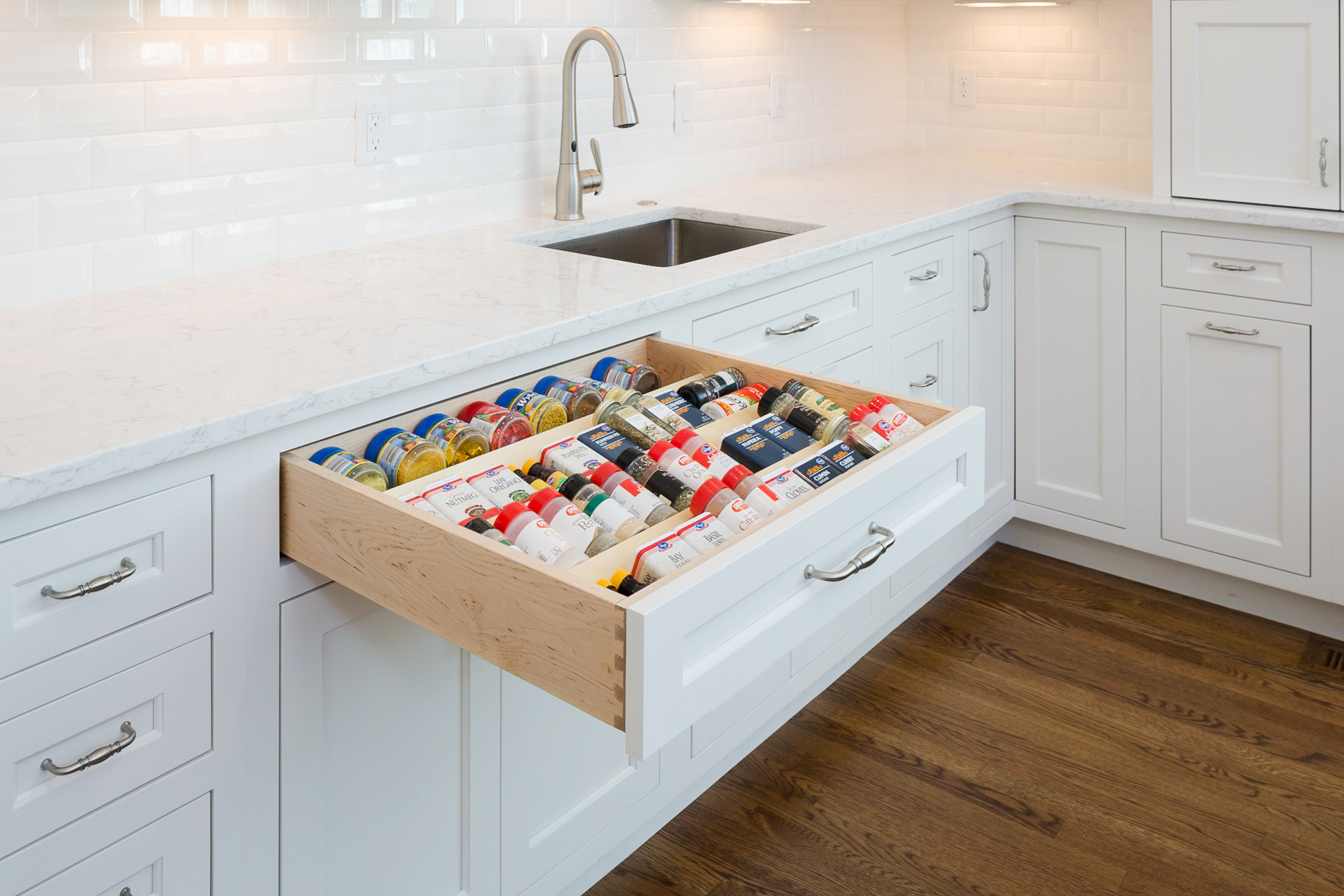Spice drawer in a white kitchen