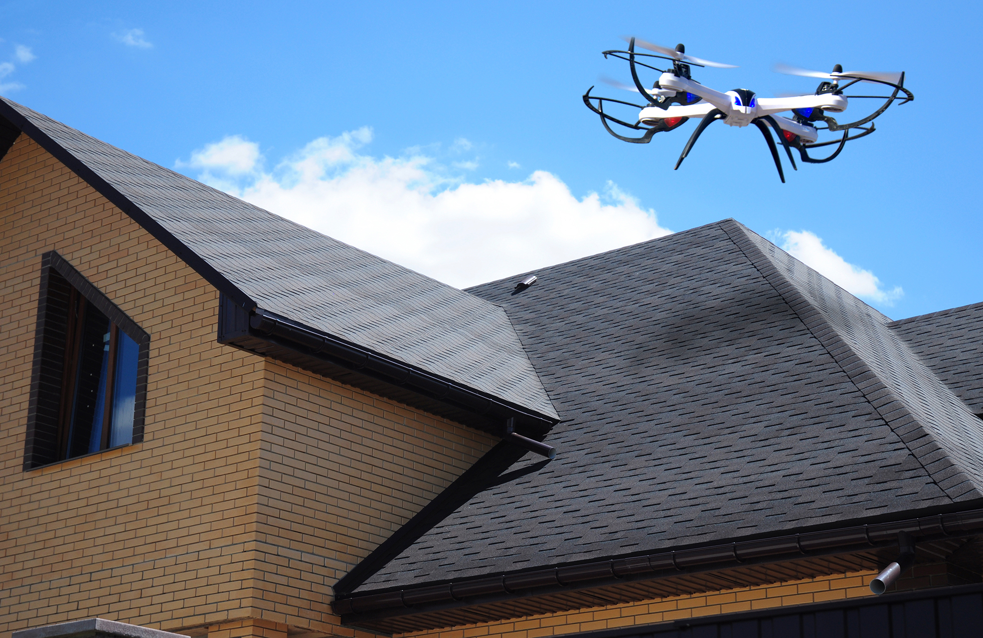 A drone flying above a rooftop