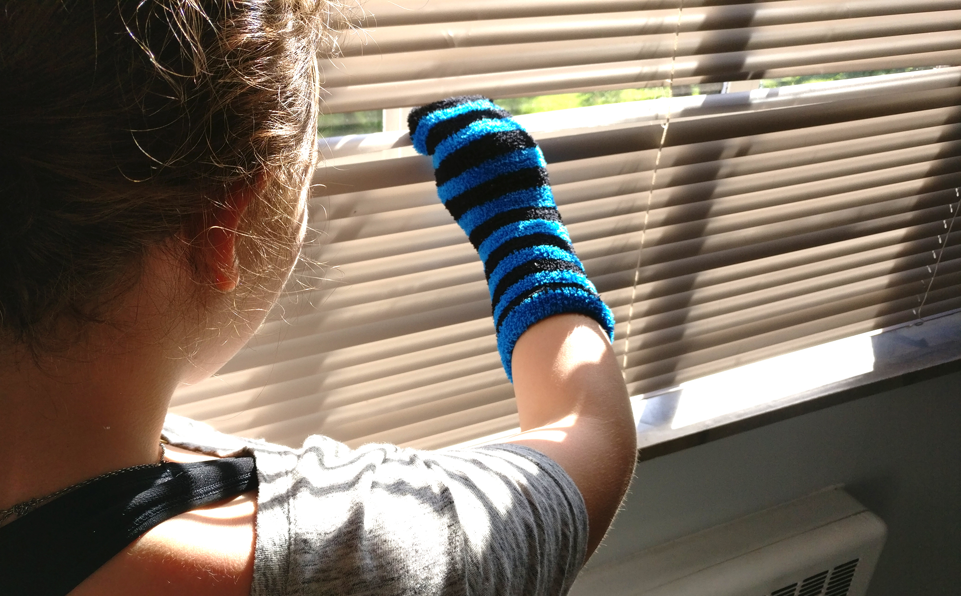Cleaning hack using socks with blinds