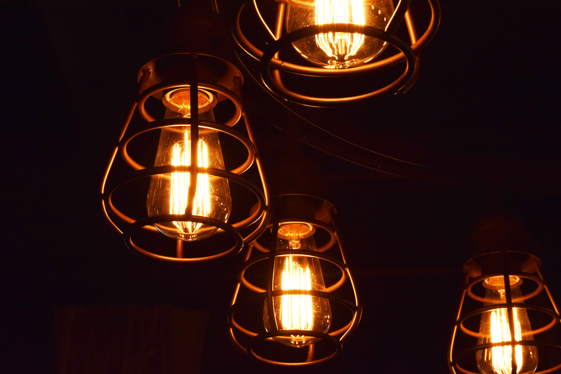 Four cage lights in a dark room | House-Selling Tips