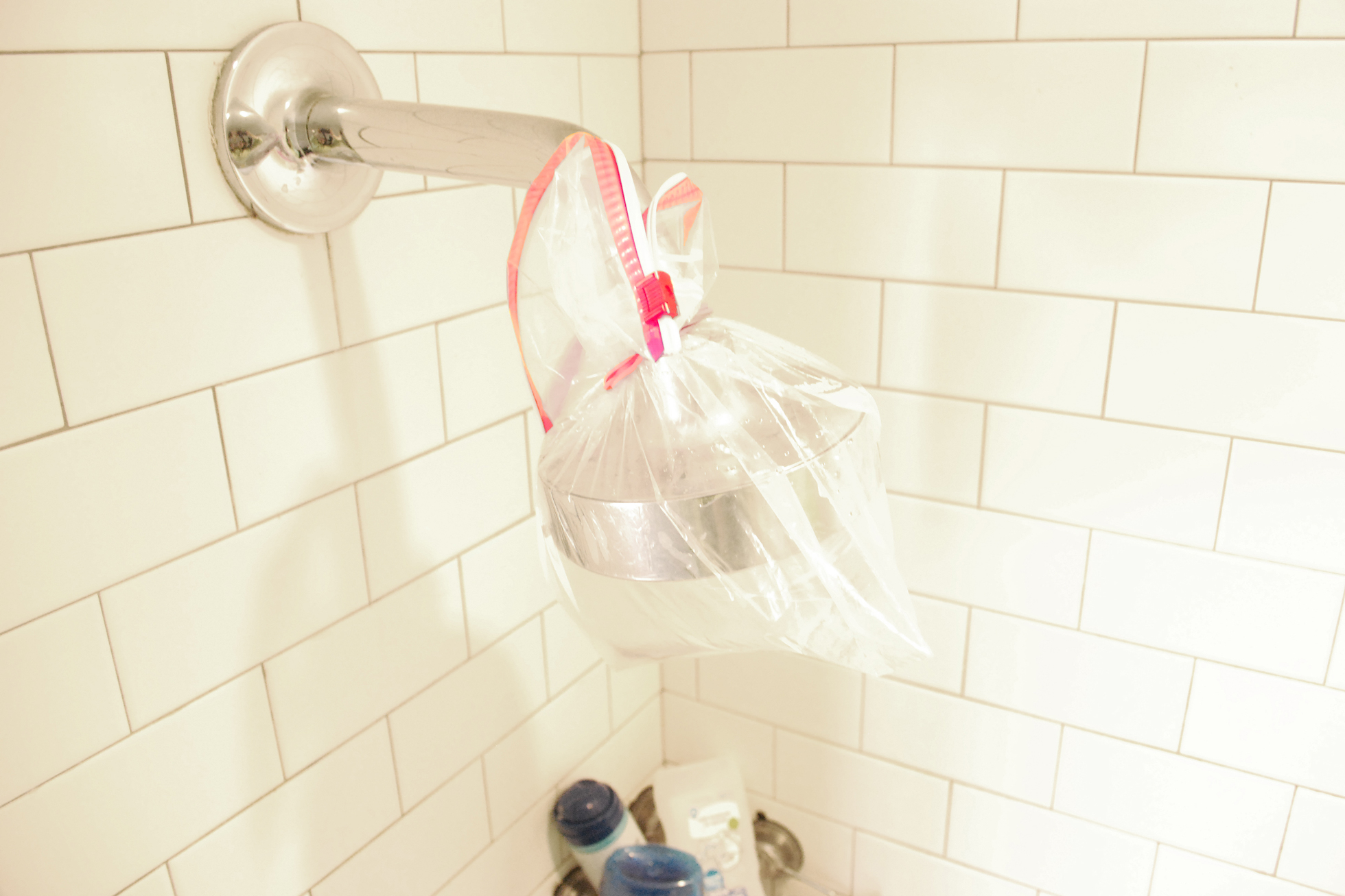 Cleaning a showerhead with vinegar