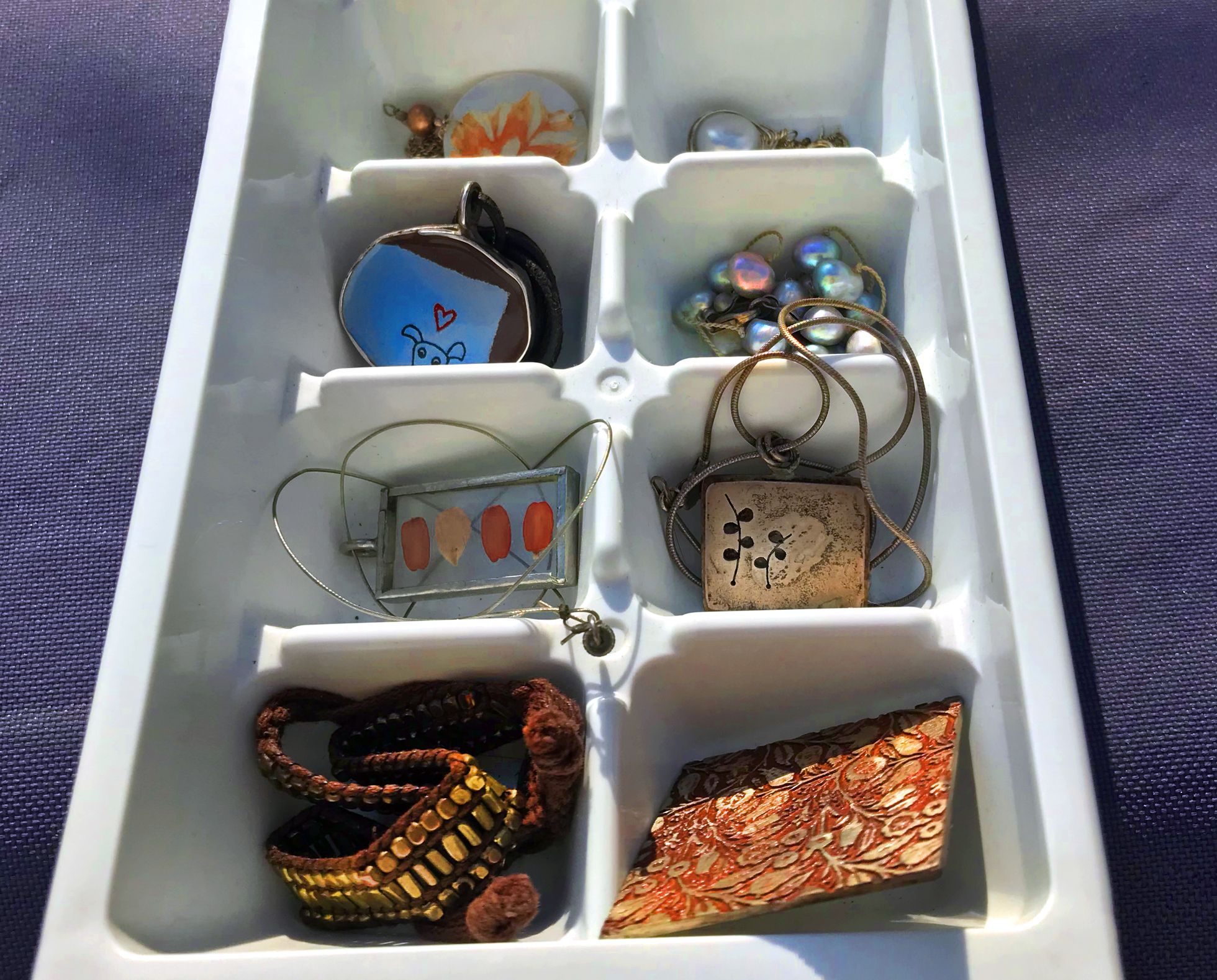 Ice cube tray used as to declutter jewelry storage