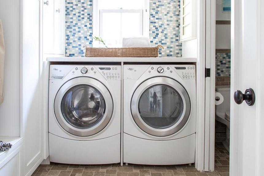A bright white laundry room with washer and dryer