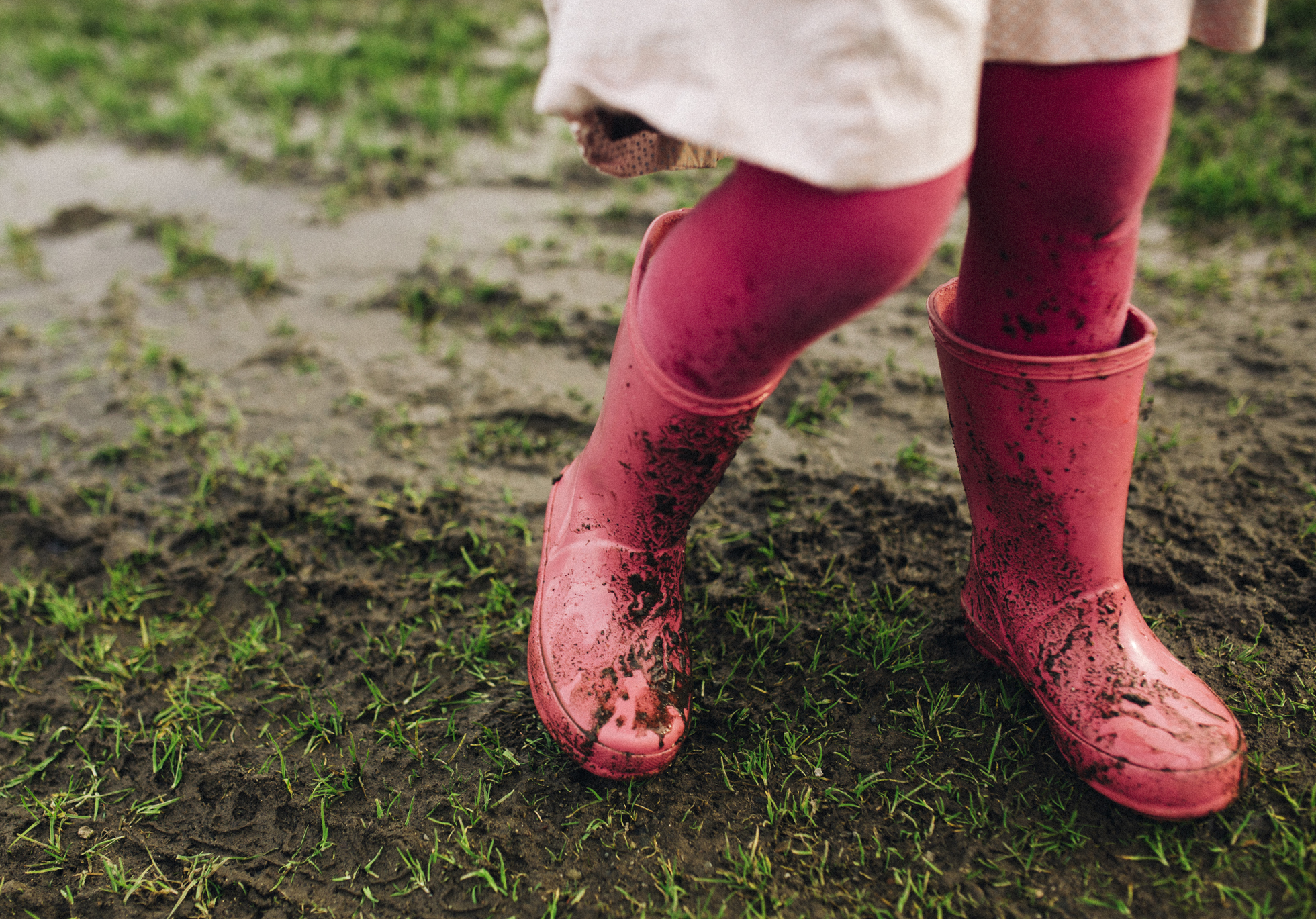 Rainboots in a mud puddle