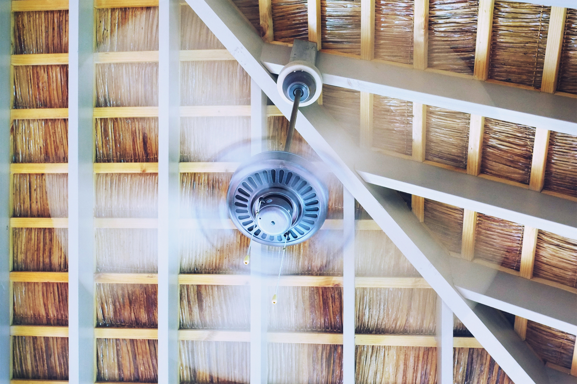Ceiling fan spinning in a house