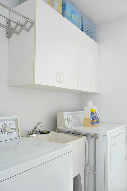 White washer and dryer with with white cabinets