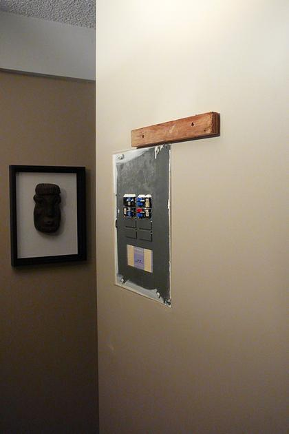 Utility box on a living room wall
