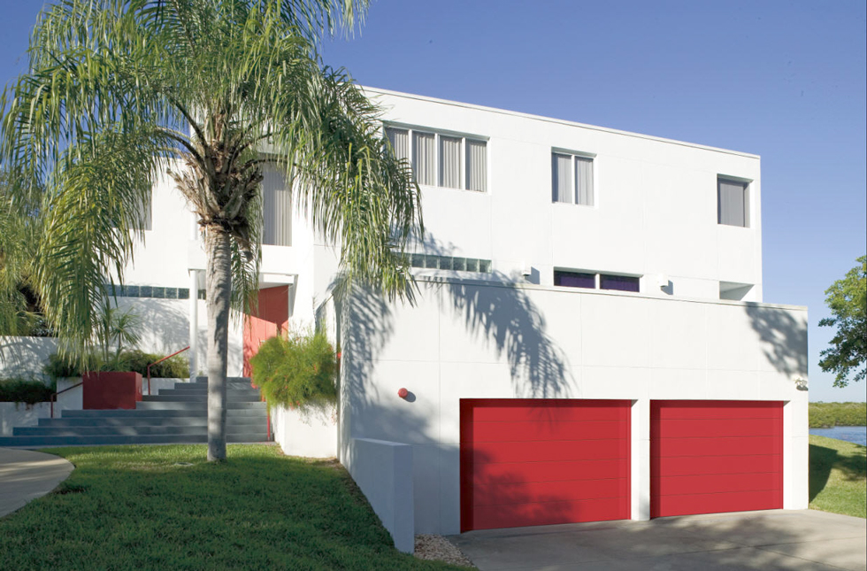 White house with bright red garage door