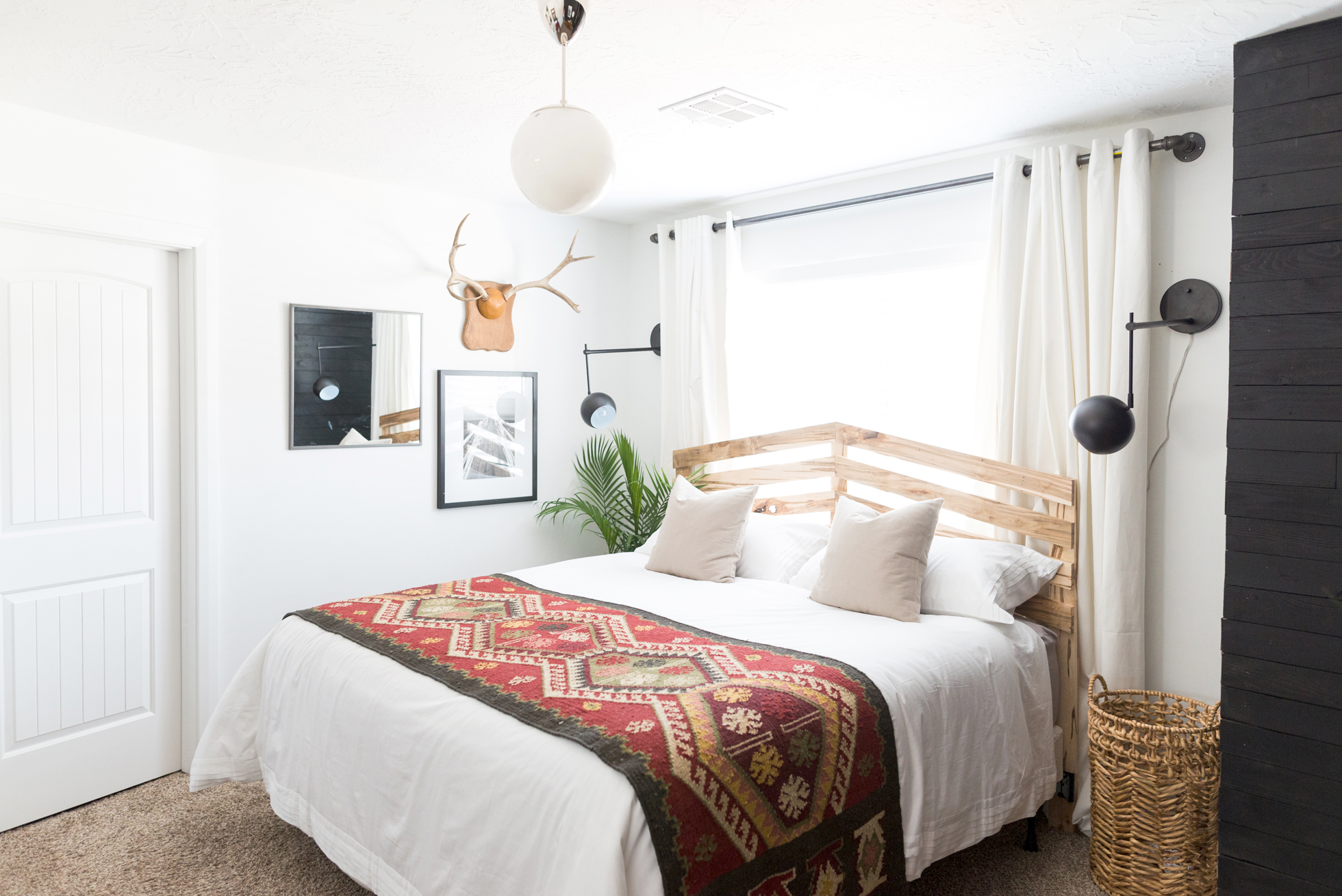 White bedroom with wooden bed frame