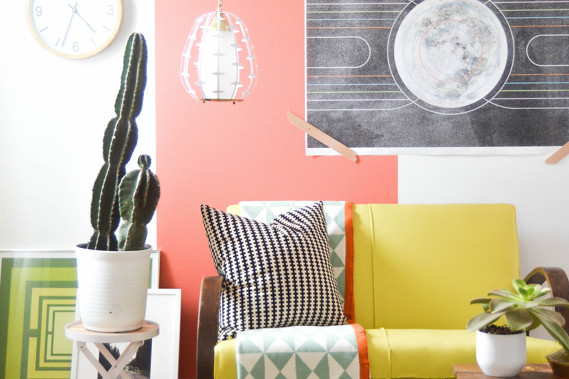 A living room with a white wall and a painted coral line