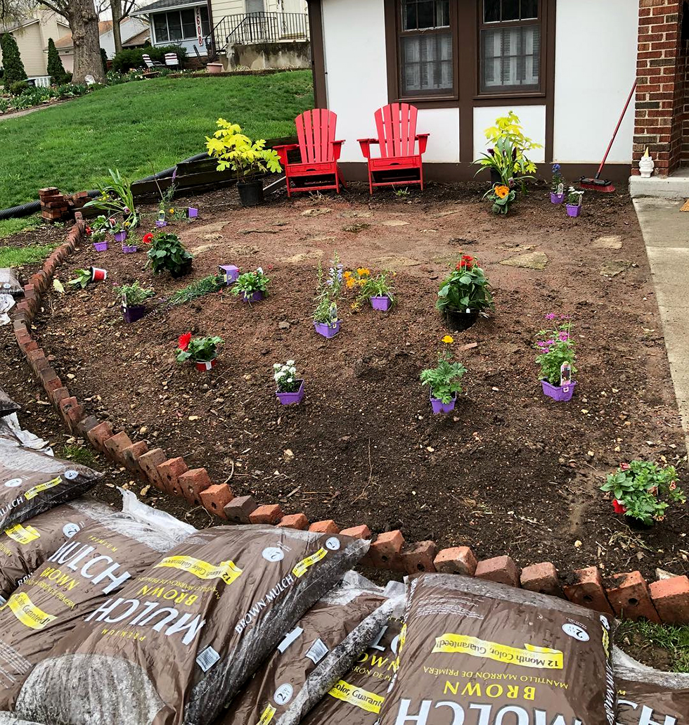 Garden with freshly planted flowers awaiting mulch