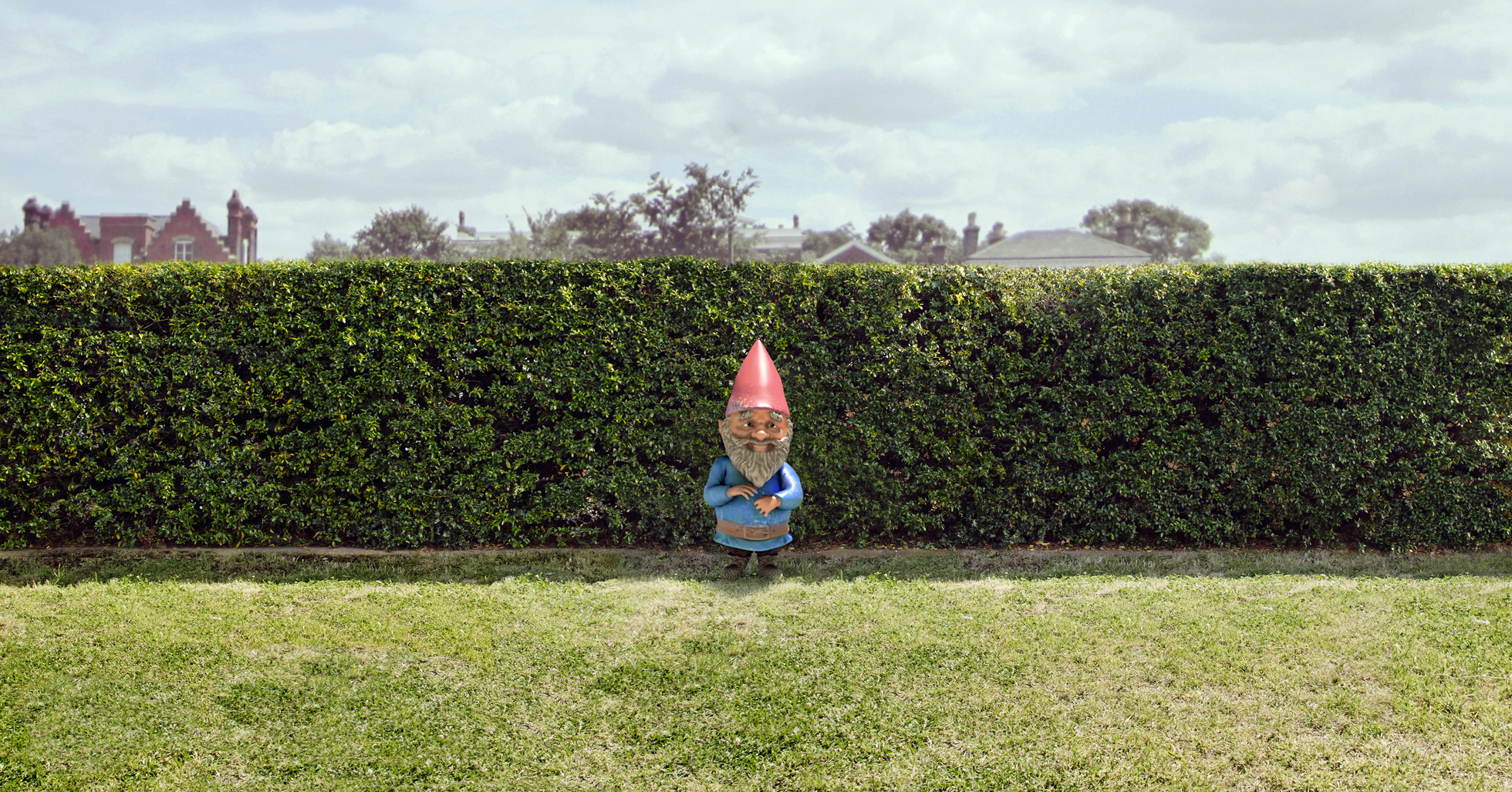 Garden gnome next to a home's lawn