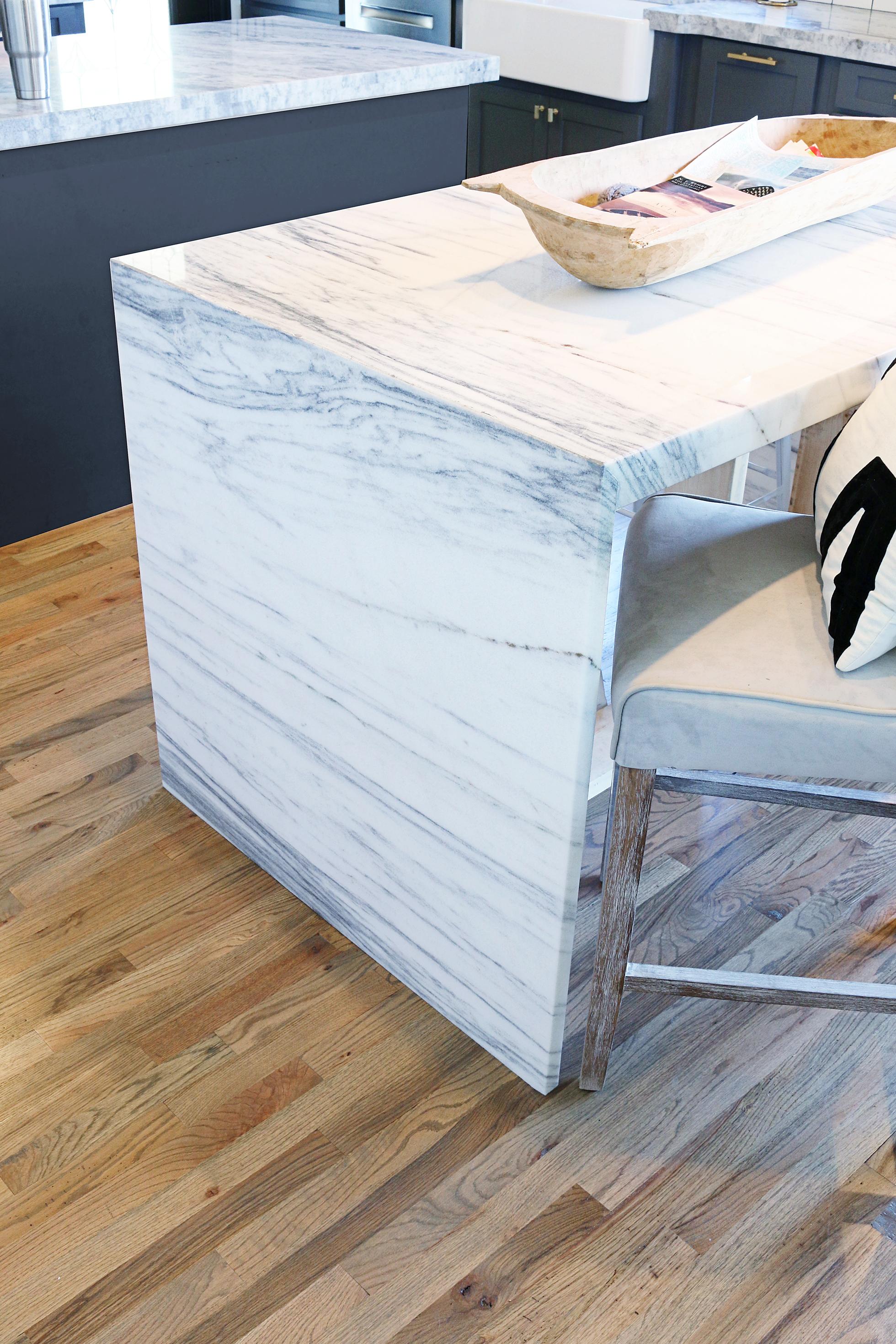 Gray kitchen countertops with wood floor