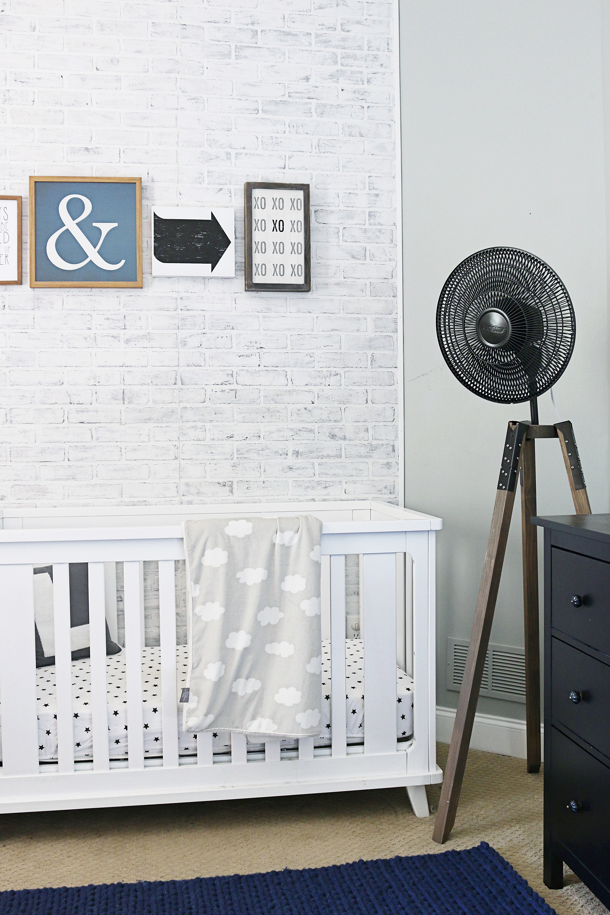 A nursery with gray-painted brick walls