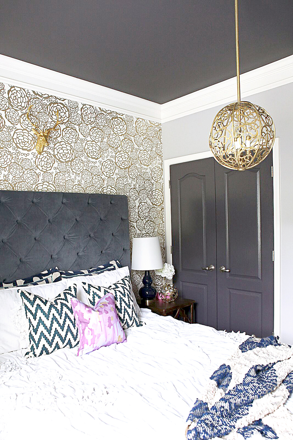Gold and white wallpapered bedroom walls