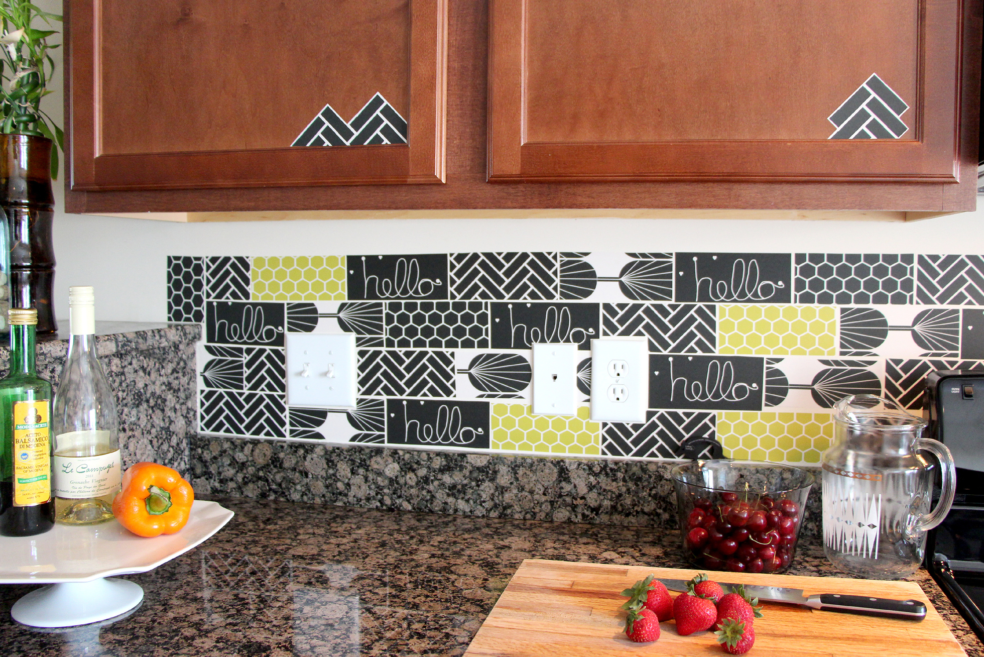 Black and green tile decals in a kitchen