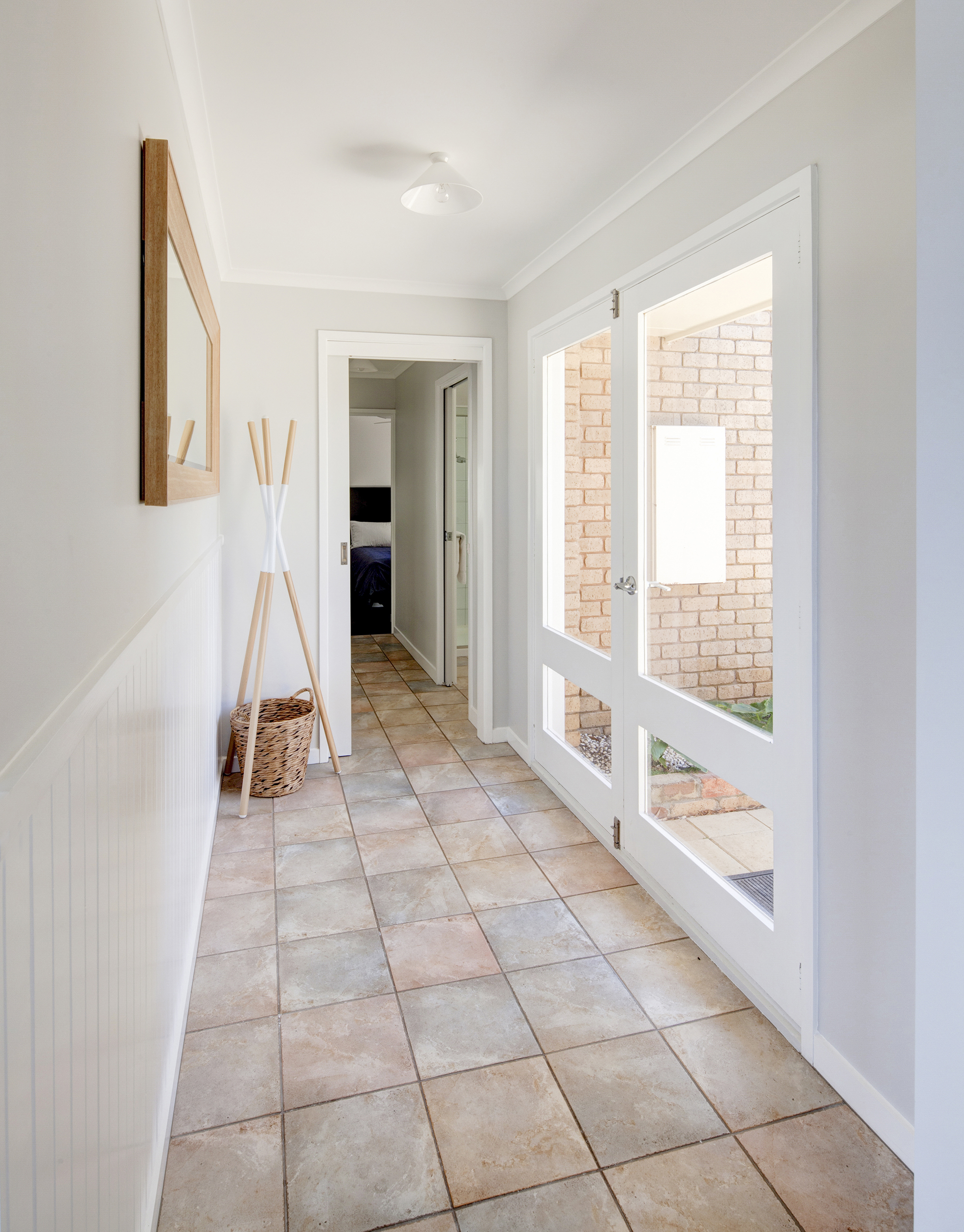 White hallway with stone tile | Keeping Clean with Dogs