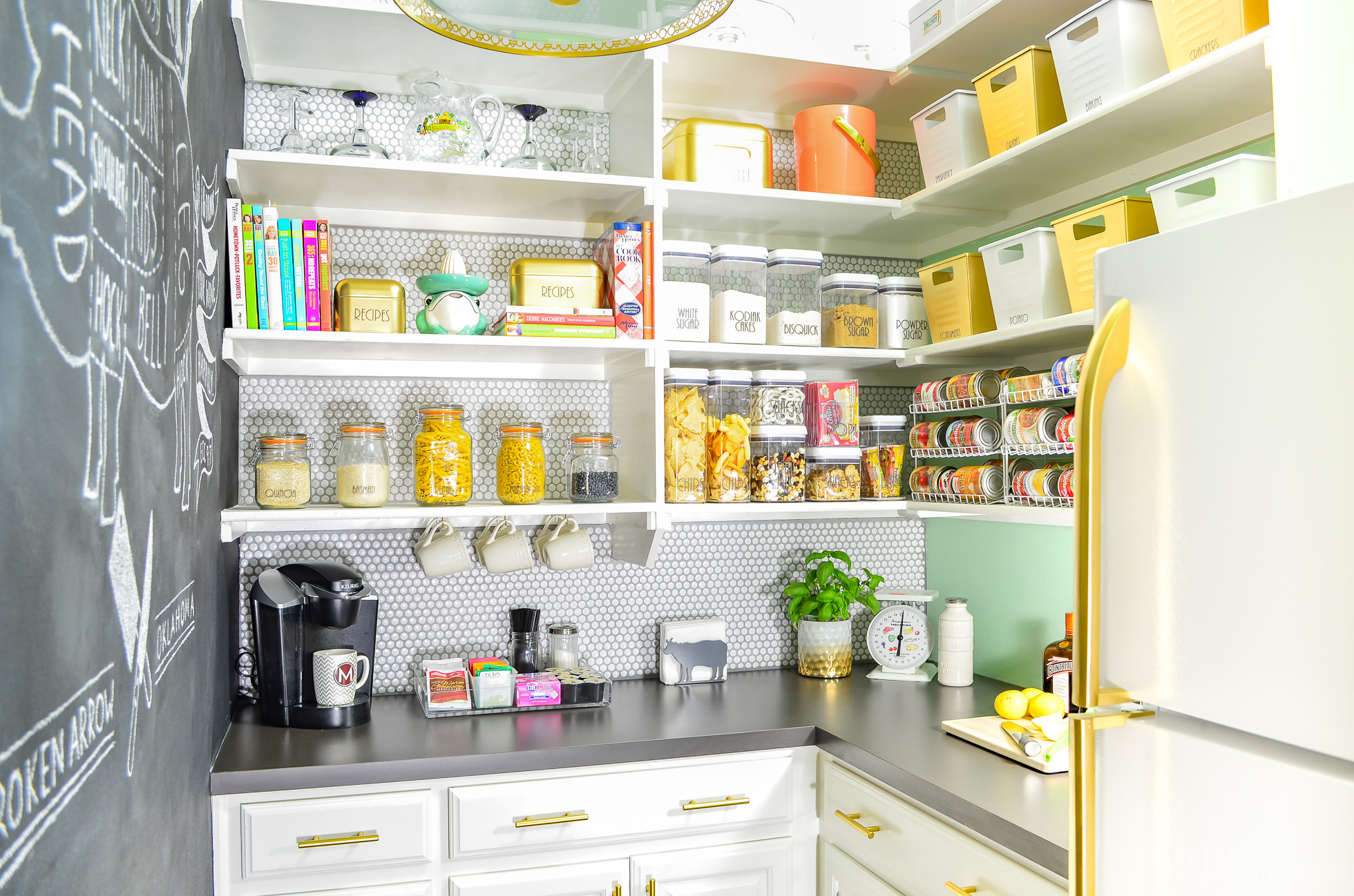 A bright green and gold pantry with food