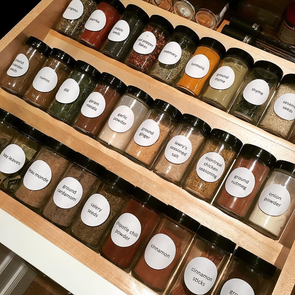 Spices with a black lid in a wood drawer