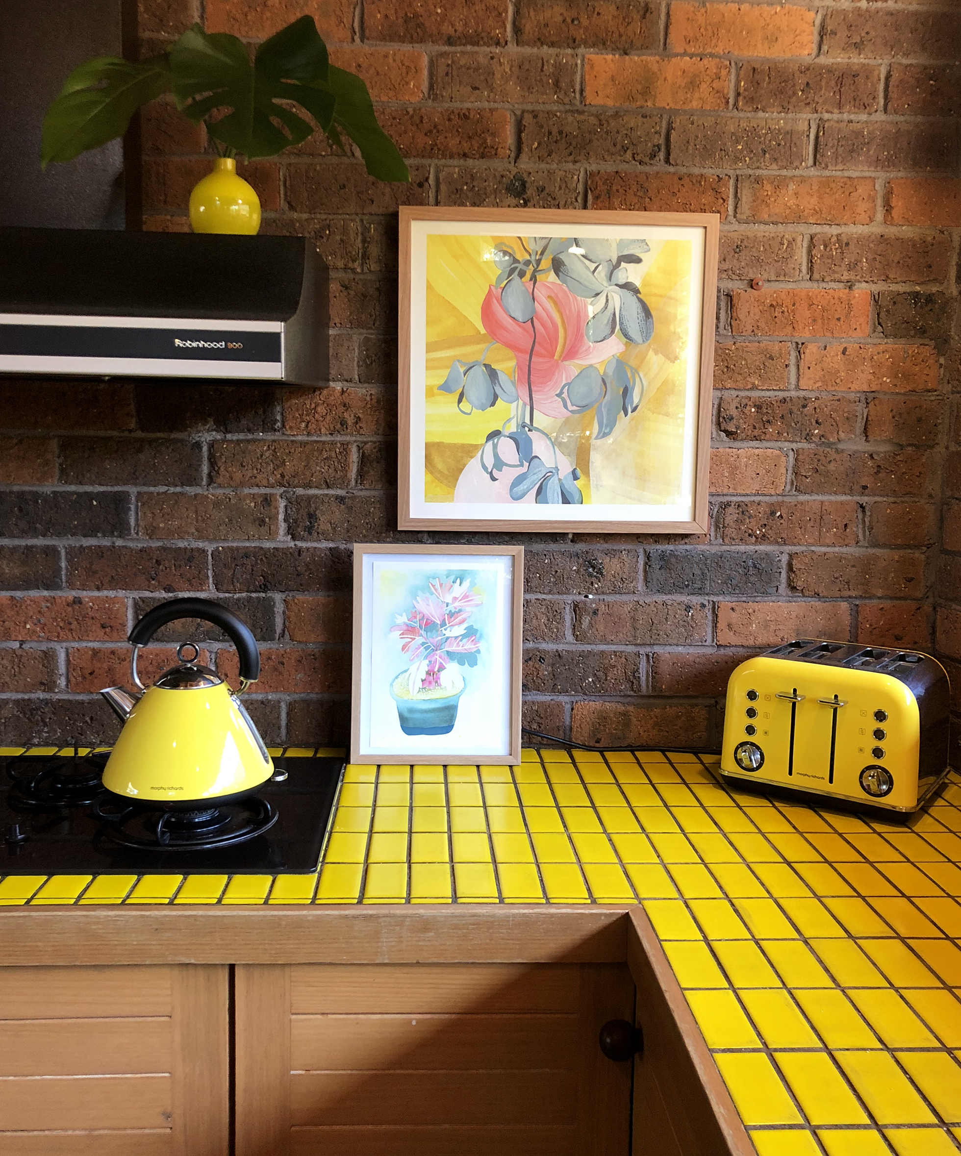 Yellow mosaic counter tops in 80s retro kitchen