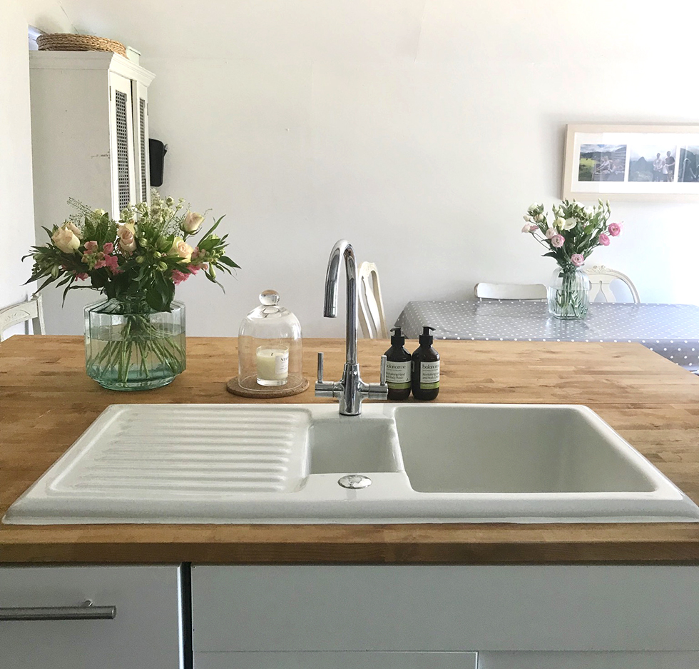 White sink in butcher's block counter | Kitchen Remodel