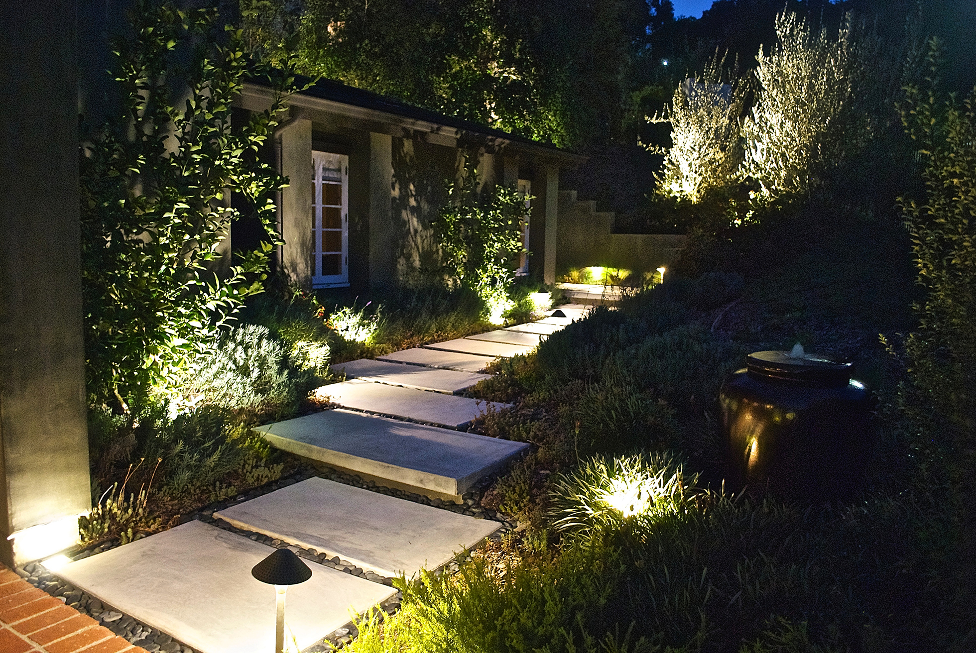 Front yard in Southern California illuminated at night