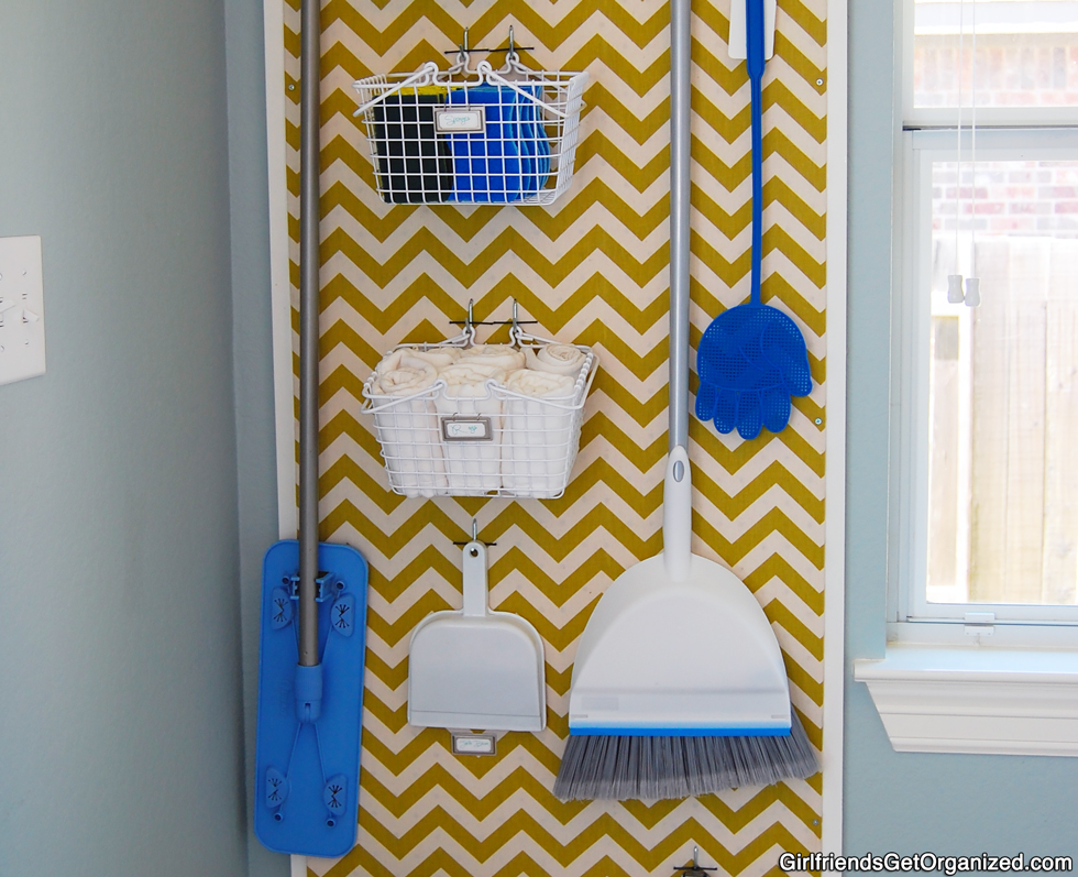 Yellow chevron design on pegboard