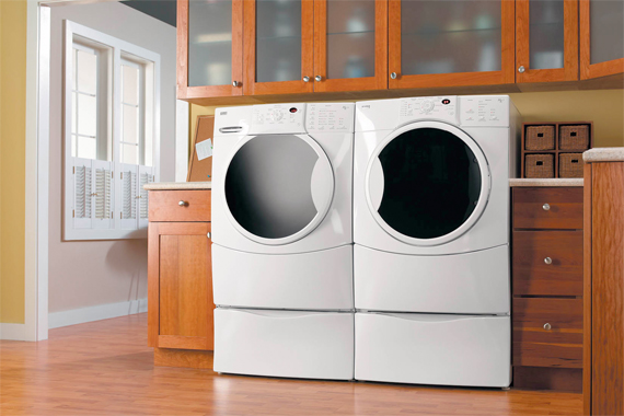 Laundry Room Storage Tips | Laundry Room Organization on counter over front-loading washer, glass washer, laundry room front loader counter top,