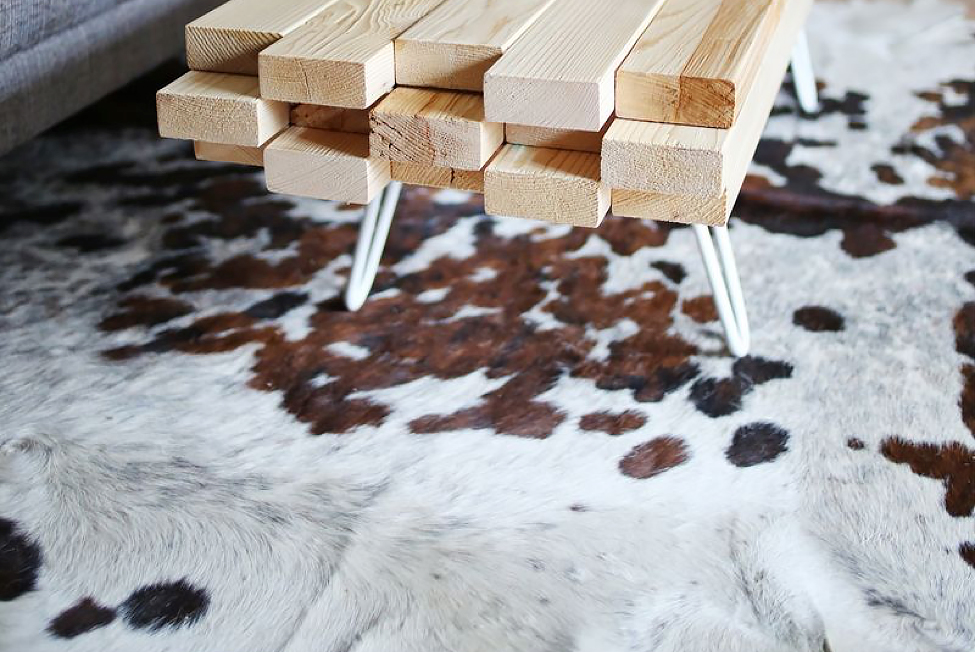 A two-by-four coffee table and cowhide rug