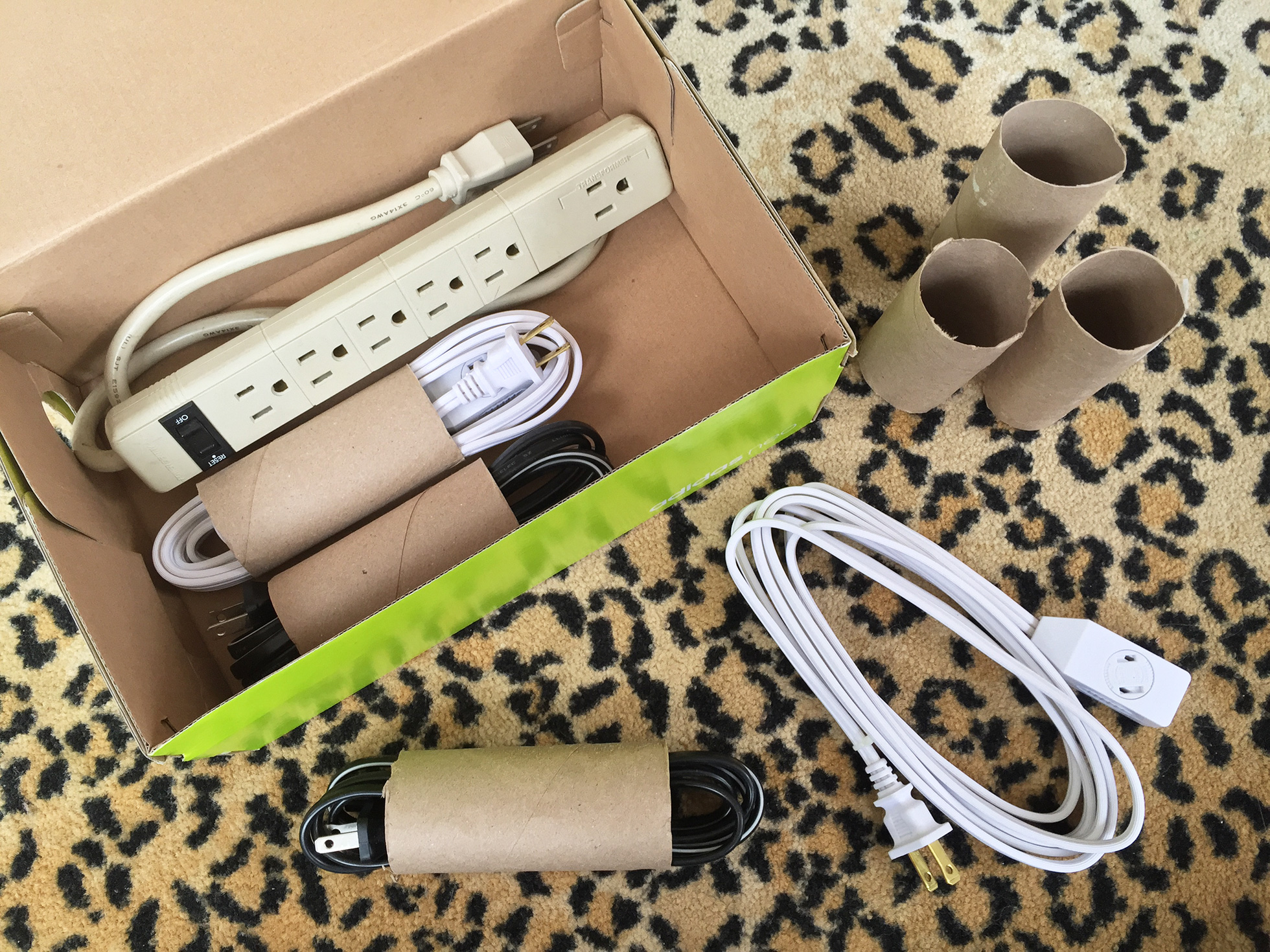Organize power cords when moving by using toilet paper rolls