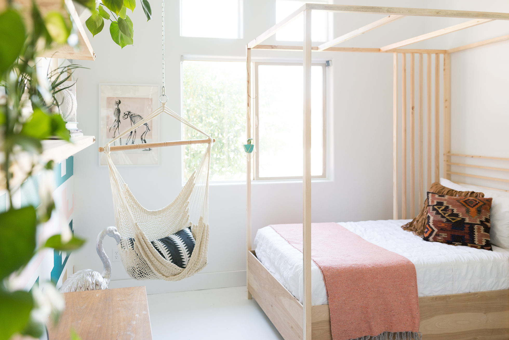 Bright bedroom with wood frame canopy bed