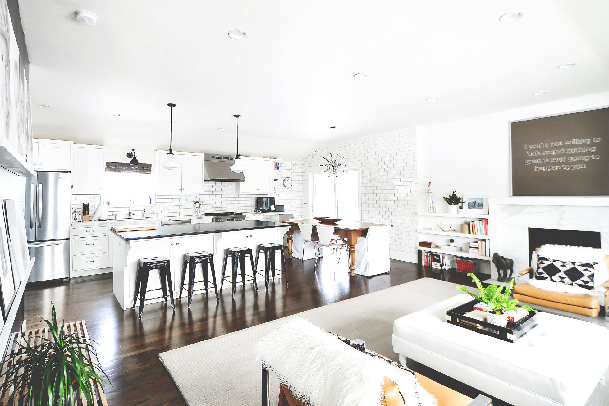 Wide shot of bright white living room, kitchen