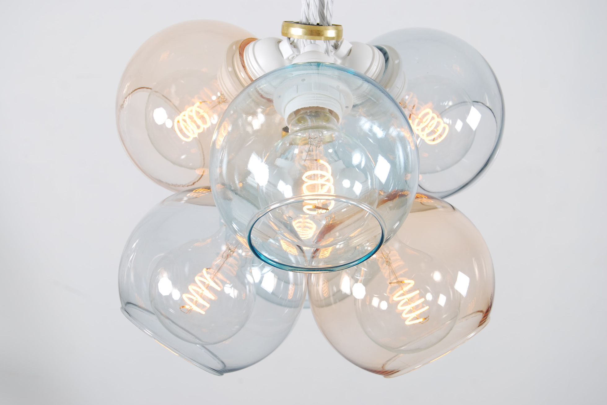 A group of clear stylish light bulbs
