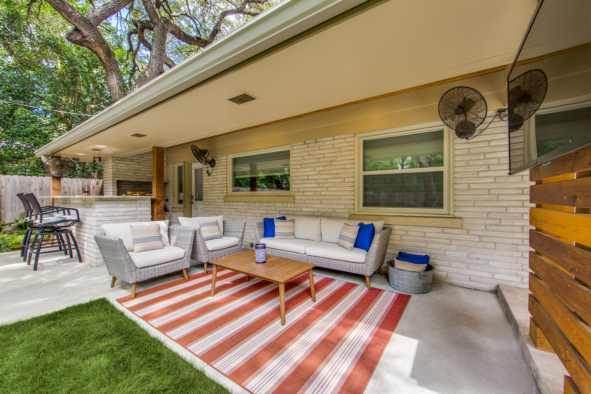 Orange striped carpet and wood table in outdoor living area
