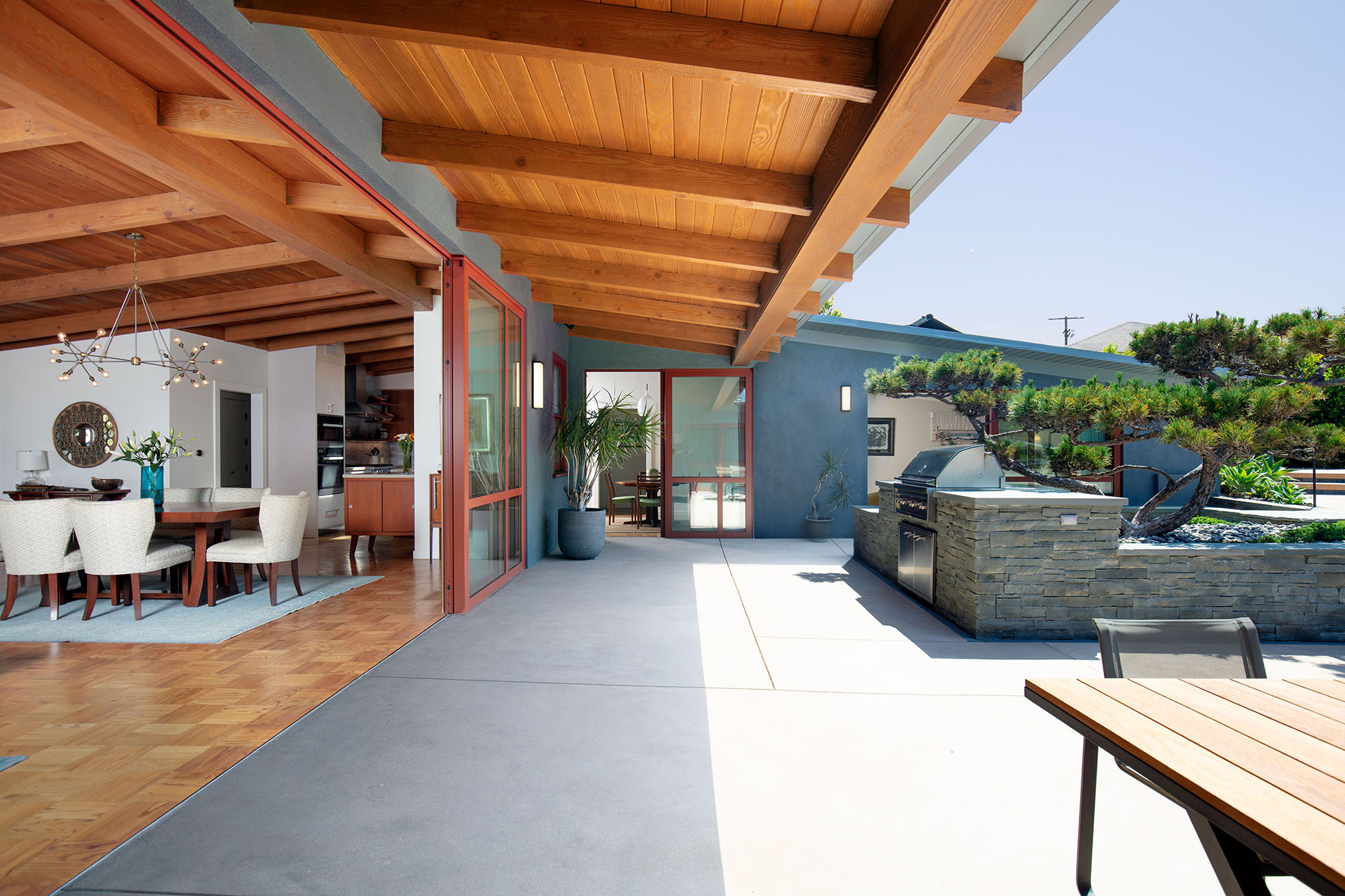 Outdoor entertaining area with sliding door and kitchen