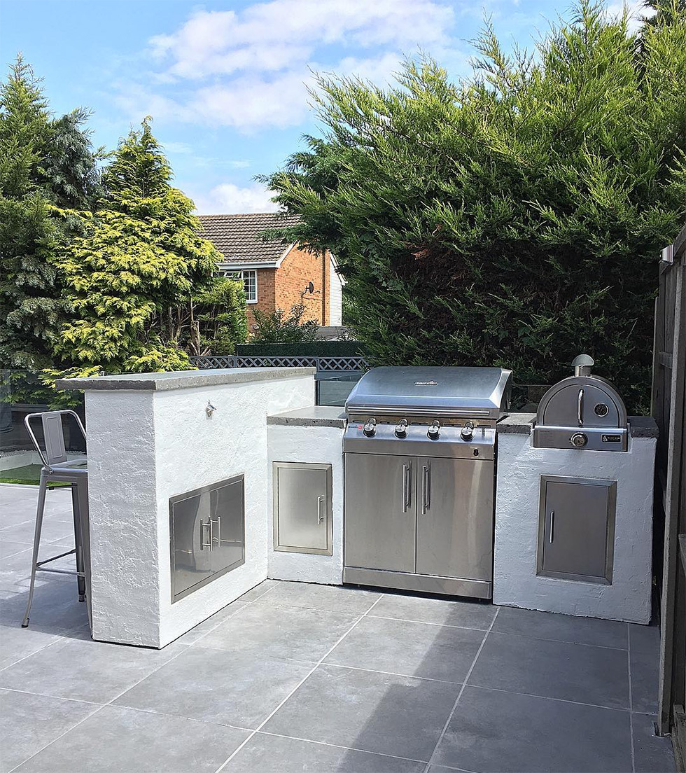 White concrete and stainless steal outdoor kitchen