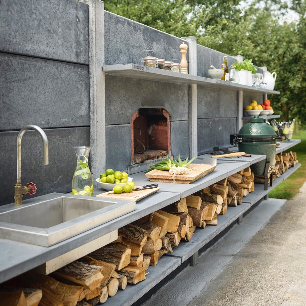 Concrete outdoor kitchen with sink and wood-burning oven