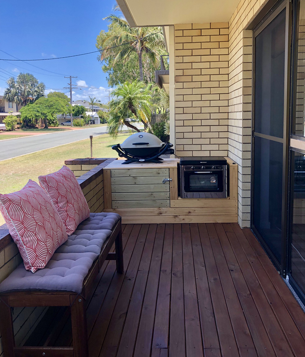 Small outdoor entertaining area with grill and oven