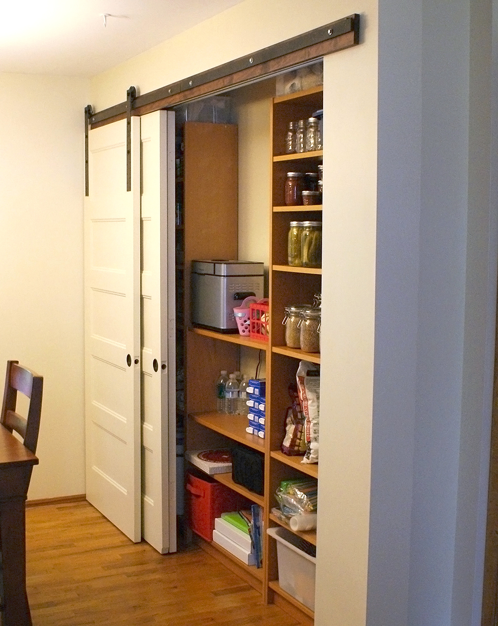 Sliding barn door in a pantry