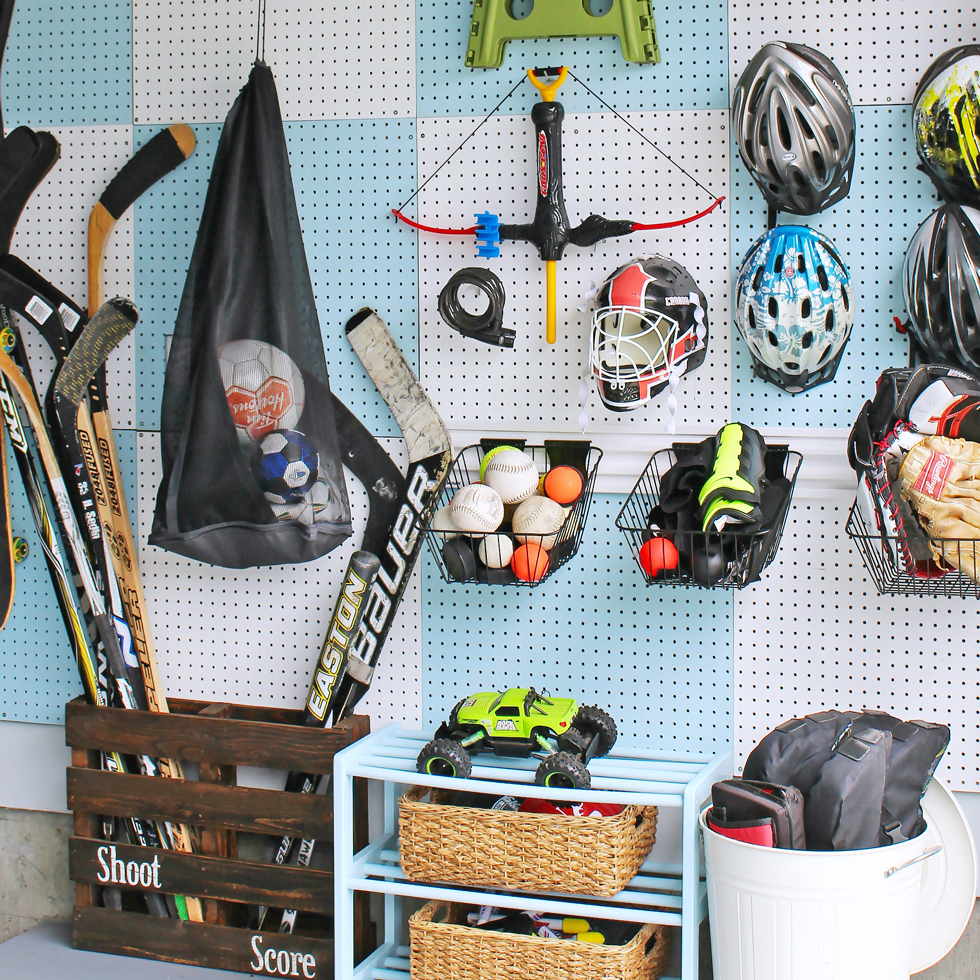 White and blue pegboard in a garage with sports equipment