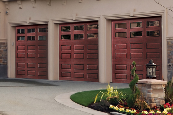 Faux wood garage doors look of wood at a budget price for Wood looking garage doors