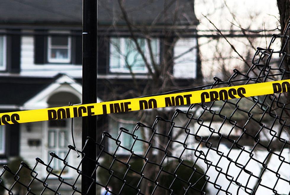 Crime scene tape outside of a house