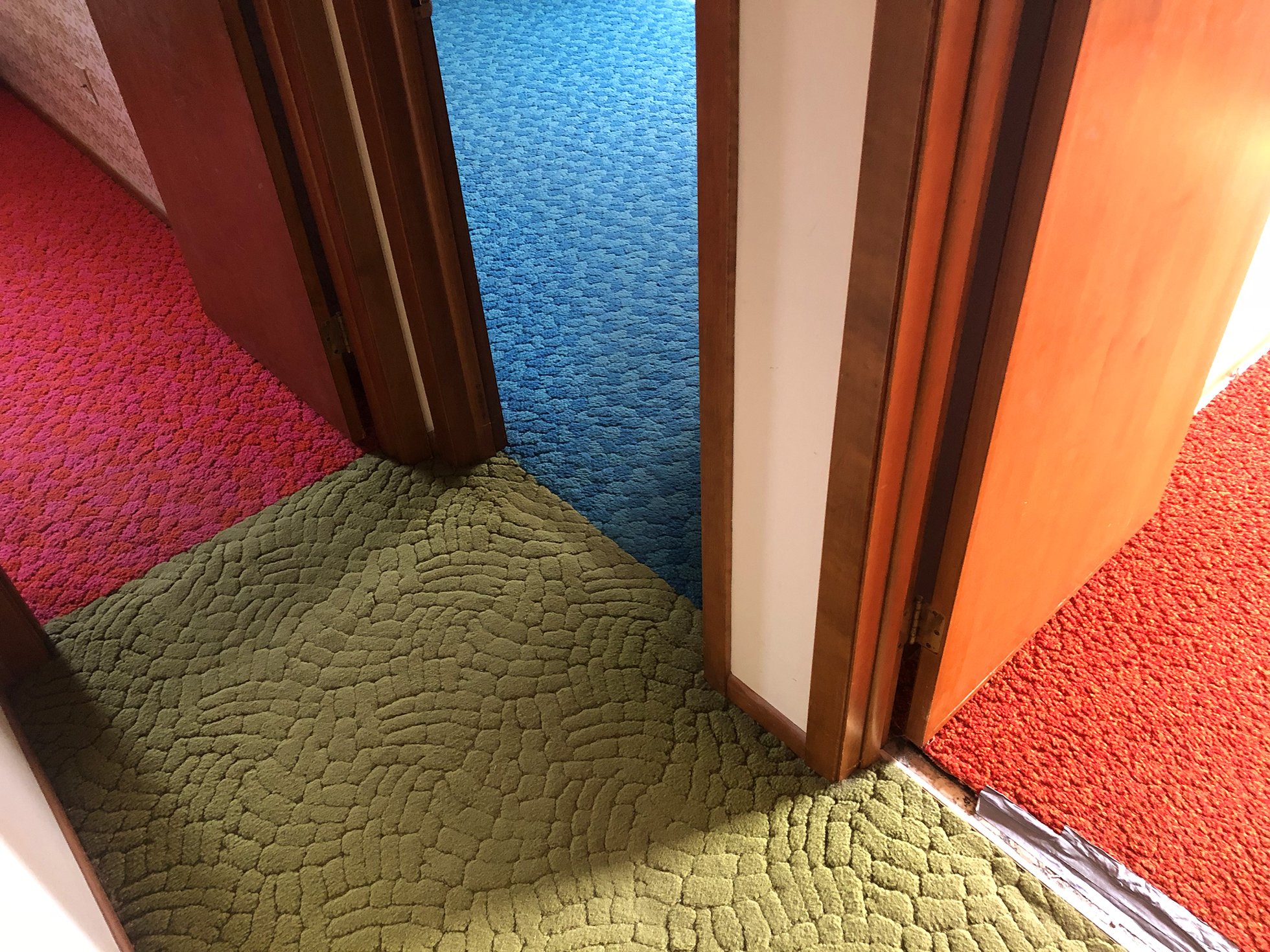 Multiple carpets in retro sixties colors converging