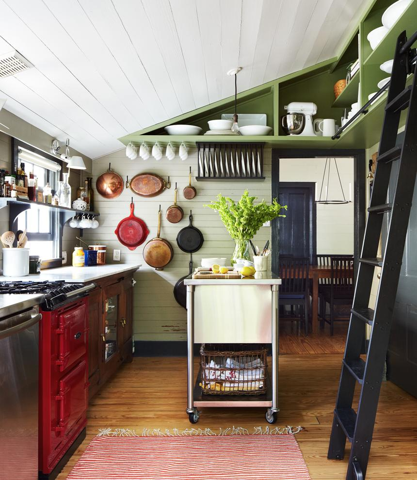 Green open shelving in a bright kitchen
