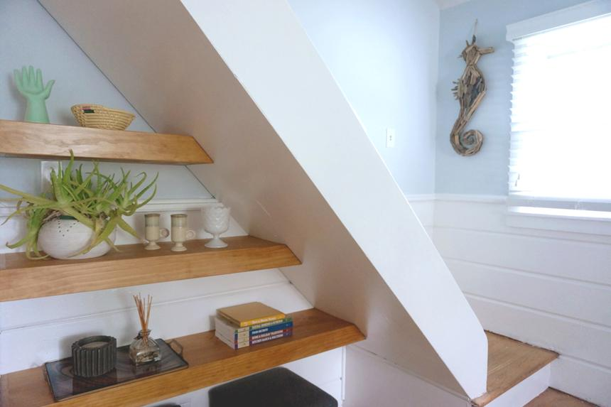 Wood shelving under stairs