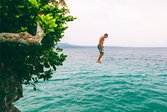 Man jumping off of a cliff