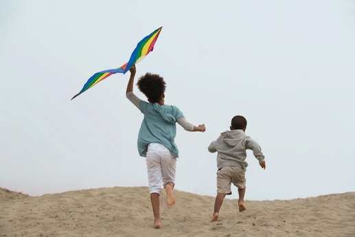 Kids flying kites at the beach